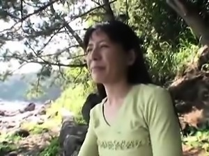 Lustful Japanese milf with a cute smile is on the lookout f