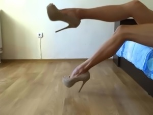 My sexy long legs in nude high heel pumps