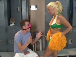 A cheerleader puts on a strapon and fucks a guy in the locker room