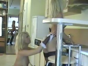 Blonde lesbians in high heels enjoy sweet licking in the kitchen