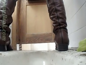 Lovely pale skin booty of a young chick in the public toilet room