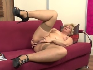 Curvy mature blonde in heels fingering pussy immensely