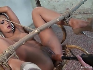 Isabella is tied up in the center of the room, gagged to muffle her orgasms...