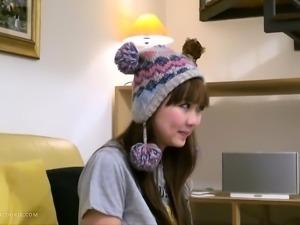Adorable asian teen masturbates in a cute hat