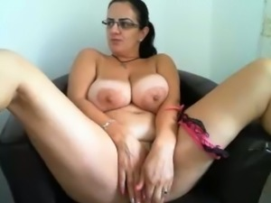 Voluptuous big boobed woman anal masturbating in solo video