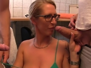 Hot chick with glasses is happy to play with a couple of fat dicks