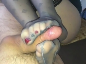 Milking his cock with her sexy nylon stockinged soles