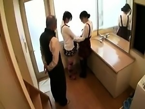 Two adorable Japanese chicks have fun with a horny guy in t