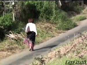 Asian pissing in public
