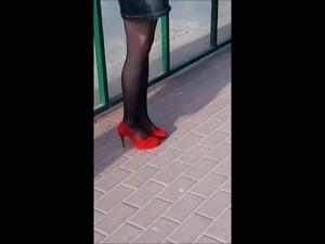 #19 Slim girl with nice legs in mini skirt and high heels
