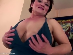 Mature mama gets young girl's fist in her vagina