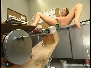 Nasty blonde chick gets toyed by a machine in her office