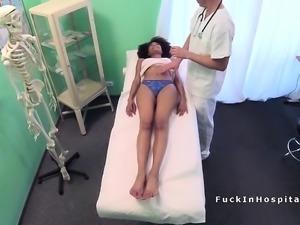 Fake doctor checking ebonys helth