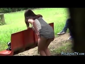 Asian pees in public park