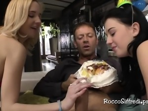 Rocco enjoys his b'day cake with blondes