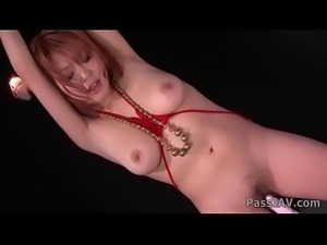 Sara in bondage has her big tits and wet pussy toyed with.