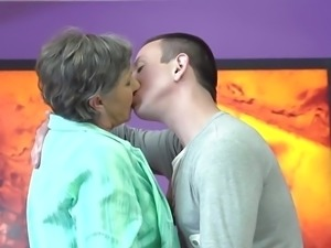 Granny gets young guest in her hairy pussy