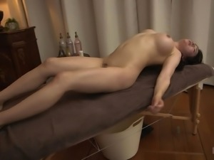 Japanese woman covered in oild wants to feel a pulsating dick