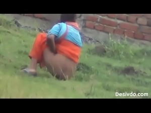 Big ass village girl shit,piss caught on outdoor