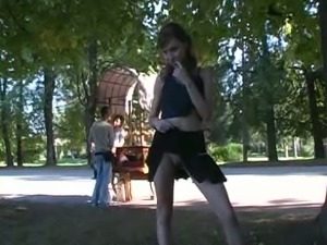Skinny redhead sexy girl in the park shows her petite ass nude