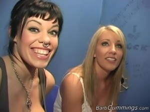 Two chicks are having so much fun in a gloryhole scene