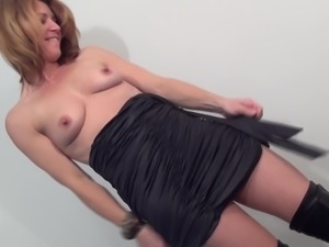 Anke wears sexy boots while masturbating with a fat toy