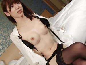 Beautiful Japanese tranny babe jerks off in black stockings