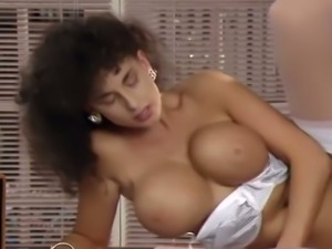 Marvelous brunette milf with big tits fucks in the office