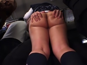Japanese babe with big tits groped by fellows on a train