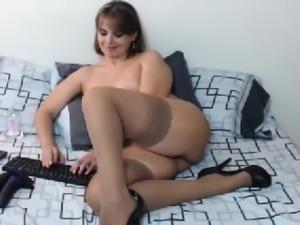 Hot blonde milf in solo masturbation show