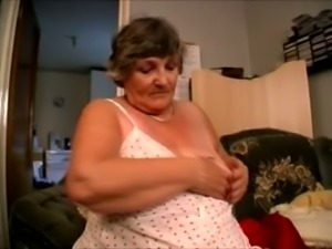 Chunky and busty white granny undresses and masturbates