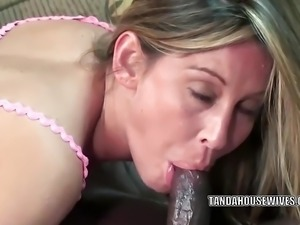 Busty MILF Leeanna Heart is swallowing some big black cock