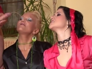 Eliss Fire and her friend enjoy a golden shower during a threesome
