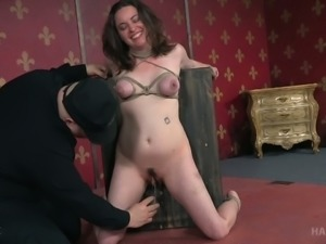 Brunette with tied up tits bound to the small wooden table