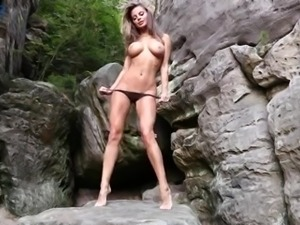 Attention seeking whore Dana Harem looks fantastic posing naked outdoors