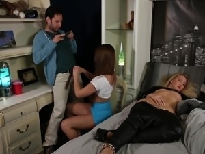 Abby Cross chokes on a fellow's dick as a blonde is sleeping