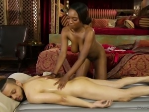 Sexy and horny black chick Daya Knight gives her client one hell of a rubdown