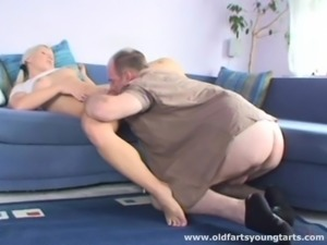 This old man fucks a gorgeous chick on the couch