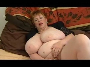 Lewd light haired mature BBW with big saggy tits masturbates herself