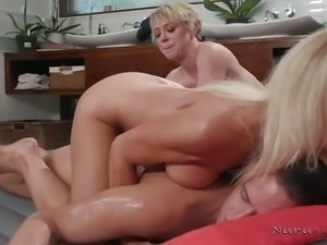 Incredibly voracious cougar Erica Lauren lets busty masseuse work on dude