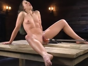 rammed in her tight pussy by a huge mechanical sex toy