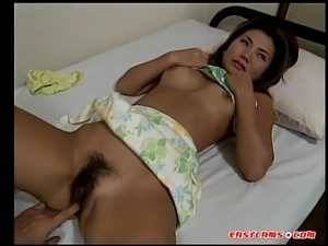 Pretty Asian gets her unshaved pussy finger fucked