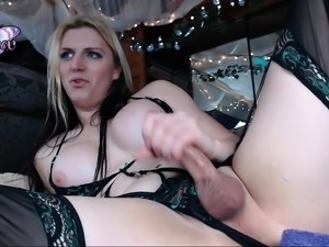 Buxom blonde shemale in stockings jerks off on the webcam
