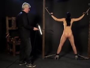Masked beauty whipped and made to suck cock