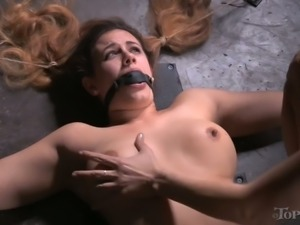 Busty red haired hooker Penny Barber gets tightly tied by her tattooed bossy pal