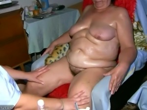 Old mature Nurse massaging Granny