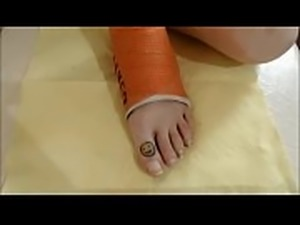 Chilling Fairy Painting her Toe Nails Red in Cast