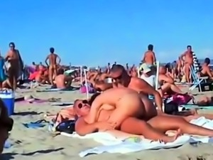 Amateur swingers enjoying hardcore group sex on the beach
