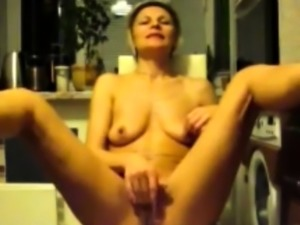 mature mom Brenda in kitchen solo