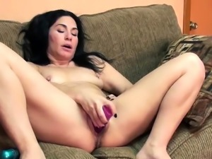 Petite brunette housewife Cleo Leroux uses a big pink dong